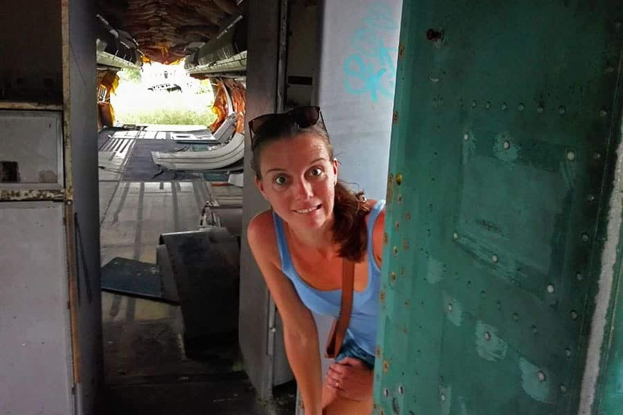 Nikki-Scott-founder-of-Southeast-Asia-Backpacker-magazine-making-a-scared-face-on-an-abandoned-plane-in-Bangkok's-aeroplane-graveyard