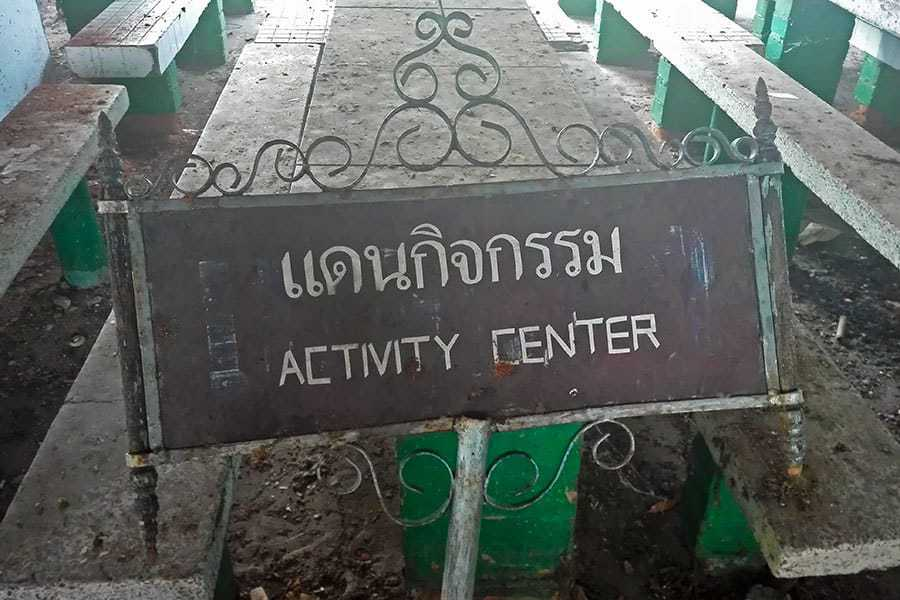 Activity-centre-sign-left-in-the-dining-room-at-the-abandoned-women's-prison,-Chiang-Mai