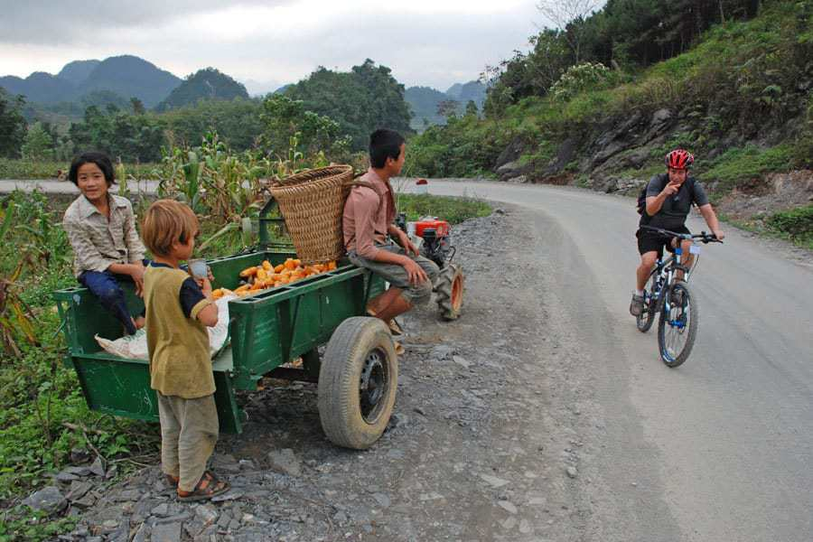 Local children stare at the crazy foreigners riding bikes through North Vietnam.