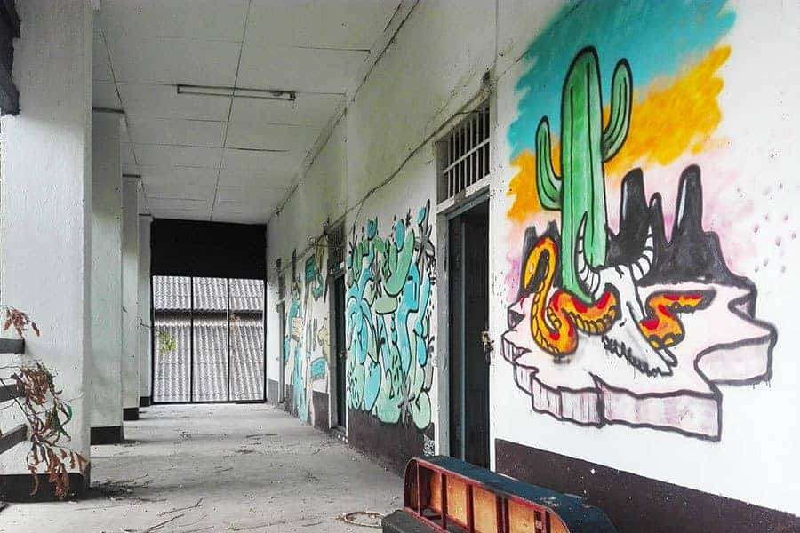 Graffiti-on-the-walls-of-the-corridor-in-the-biggest-cell-block-at-Chiang-Mai's-derelict-women's-prison