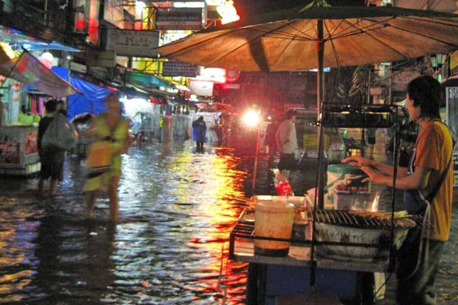 A flooded Khao San Road during monsoon season in Thailand.