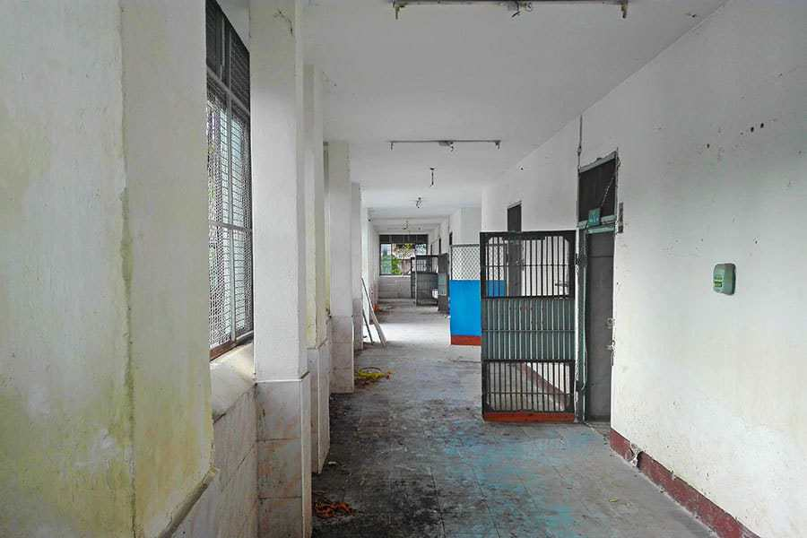 Open-doors-seen-down-the-corridor-of-the-biggest-cellblock-at-Chiang-Mai's-abandoned-women's-prison
