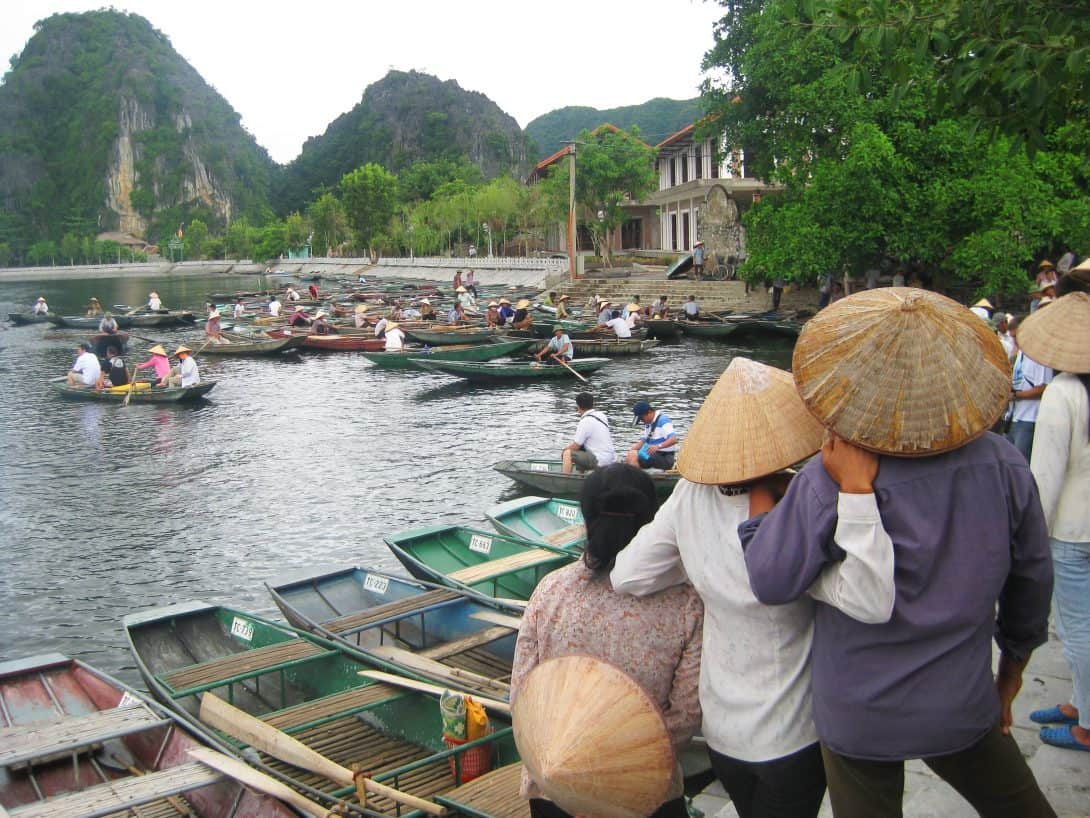 Local boating women relax at Tam Coc Lake.
