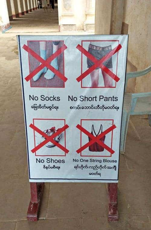 Sign outside a temple in Southeast Asia.