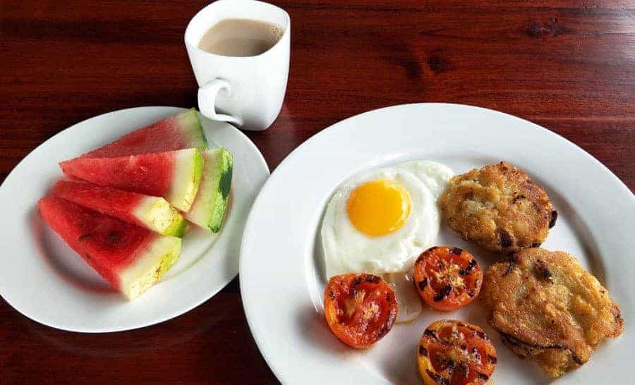 Hash browns, fried egg, grilled tomatoes and watermelon - breakfast at Myanmar Han Hotel, Bagan.