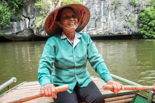 Local Vietnamese rower in Ninh Binh, Vietnam.
