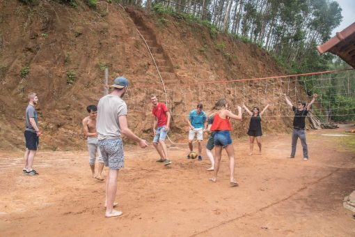 Playing volleyball on the Buffalo Run, Vietnam.