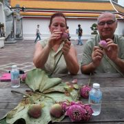 Making flower offering for Merit Grand Palace Bangkok