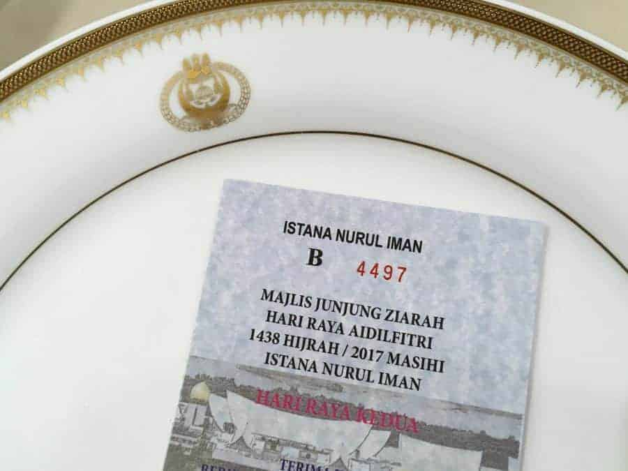 Empty plate and ticket for the Hari Raya Festival in Brunei.