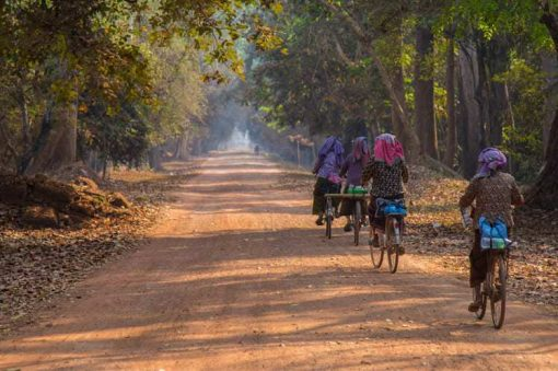 Bayon local people cycling, Siem Reap, Cambodia