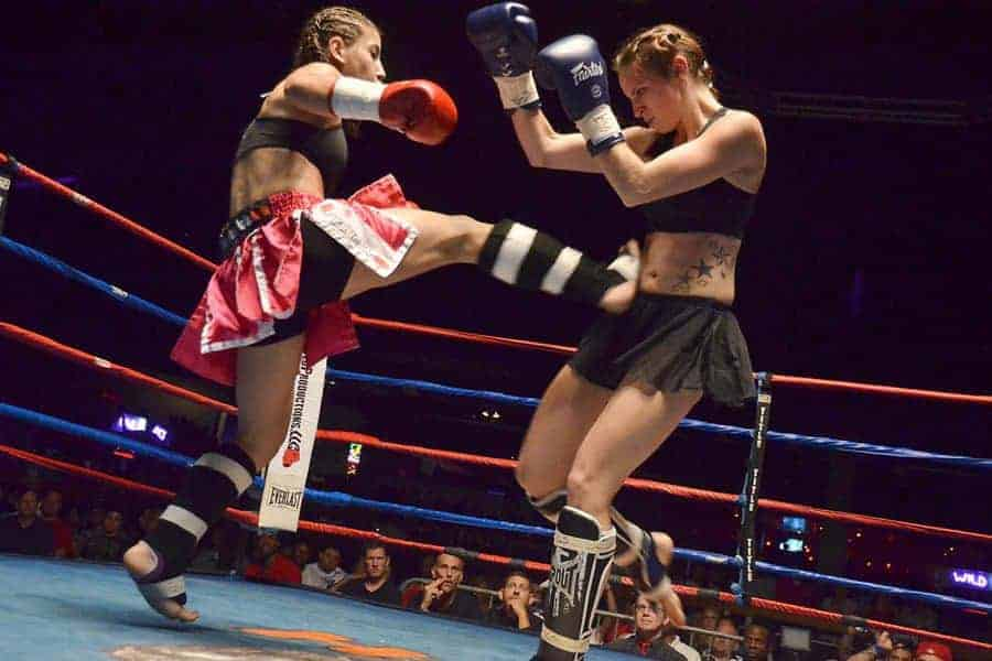 Two women fight in the ring, Muay Thai