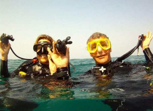 Roctopus SSI Master - Two Divers heads above the water