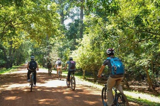 Biking through the jungle around Angkor Wat Cambodia