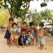 Cycler with kids in Siem Reap, Cambodia