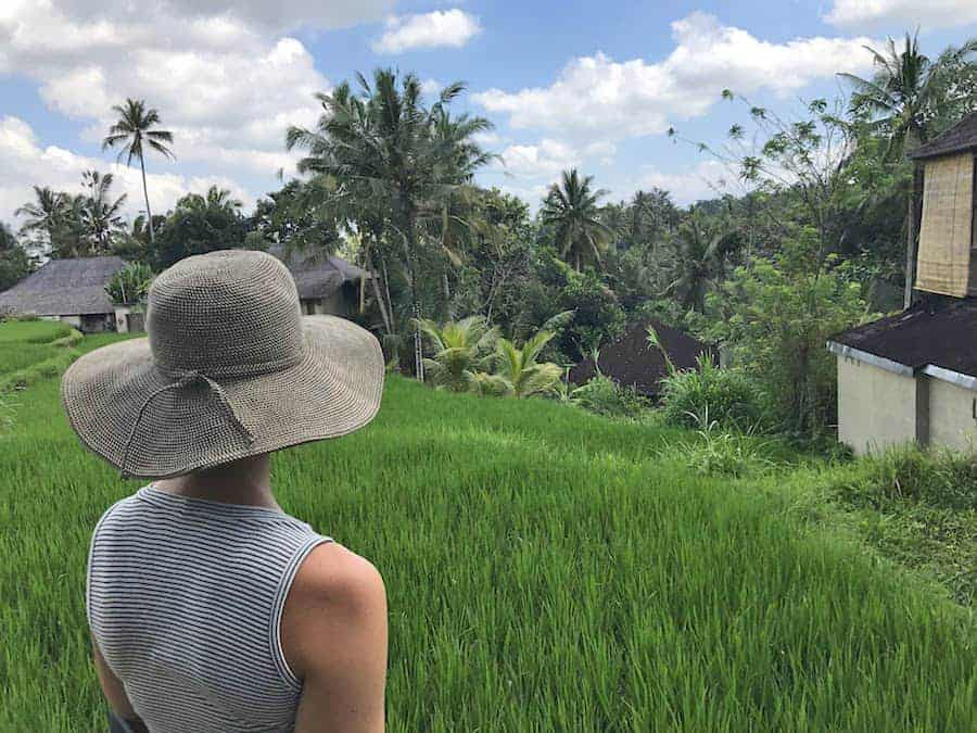Girl looks onto the rice fields of Ubud, Bali.