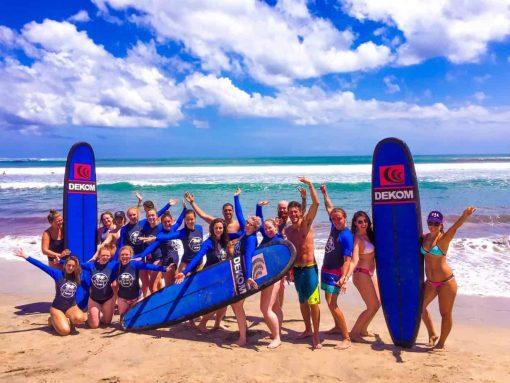 Surfing at Kuta Beach, Bali.