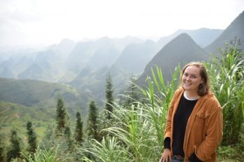 The author poses in front of a valley