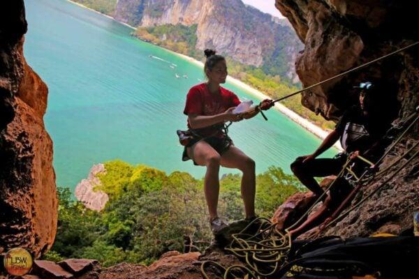Rock climbing at Railay Viewpoint, Krabi, Thailand.