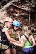 Children rock climbing at Railay Beach, Krabi.