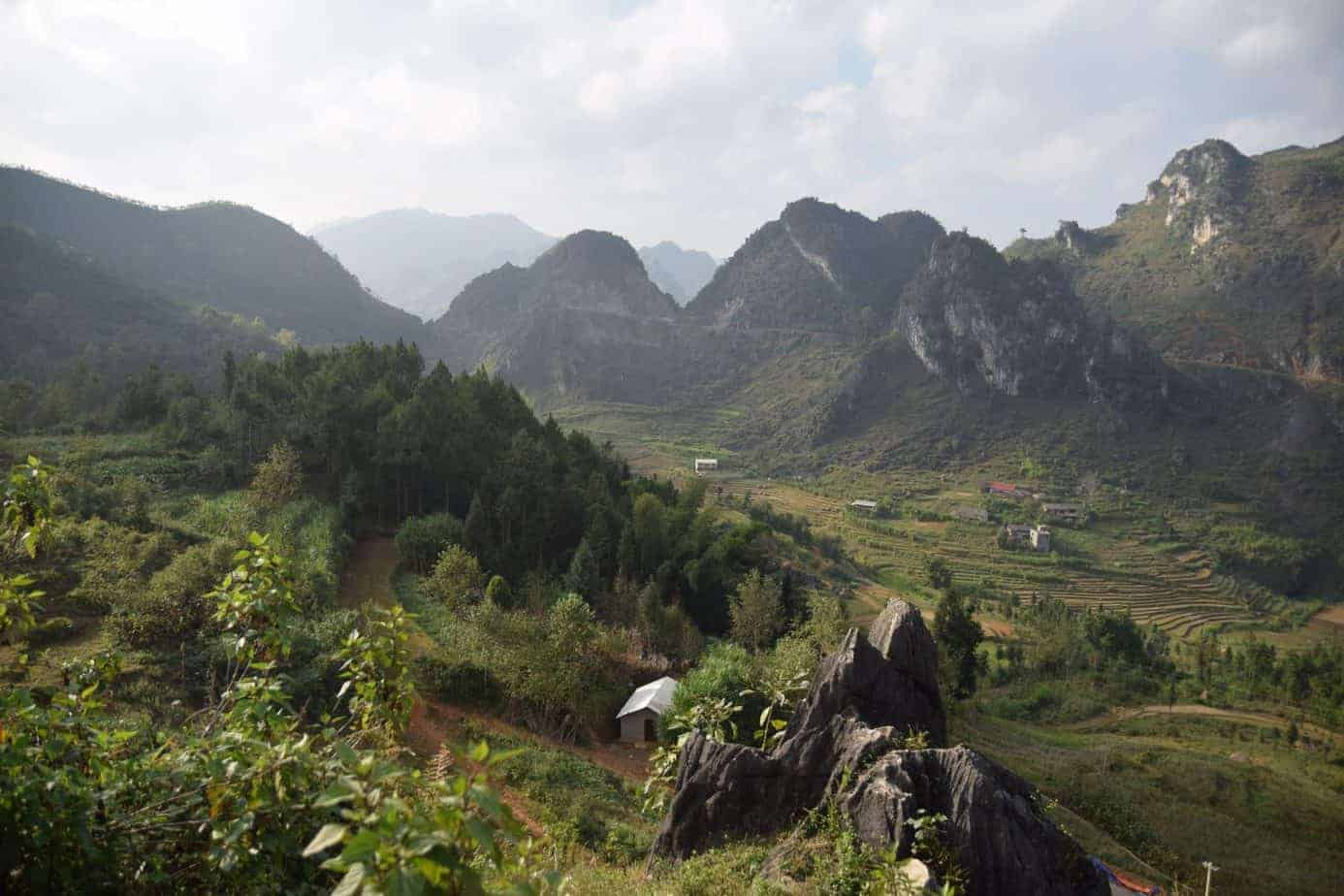 A valley with mountains in the background, Ha Giang Loop, Vietnam