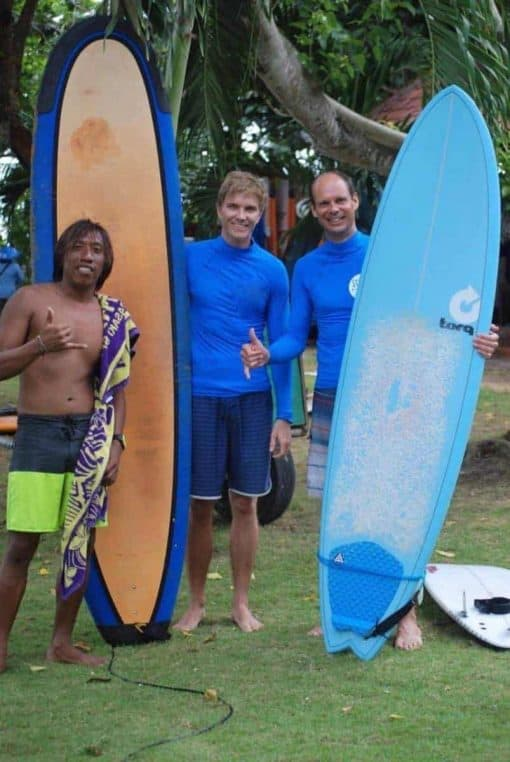 Surf instructor and students at Stoked Surf School, Bali.