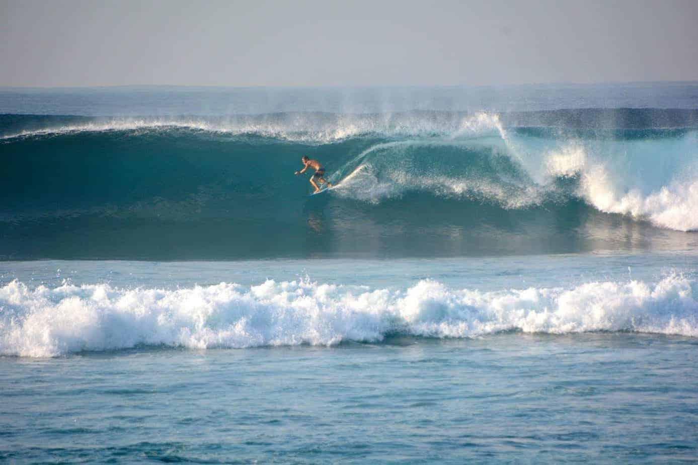 Surfing at Sanur, Bali.