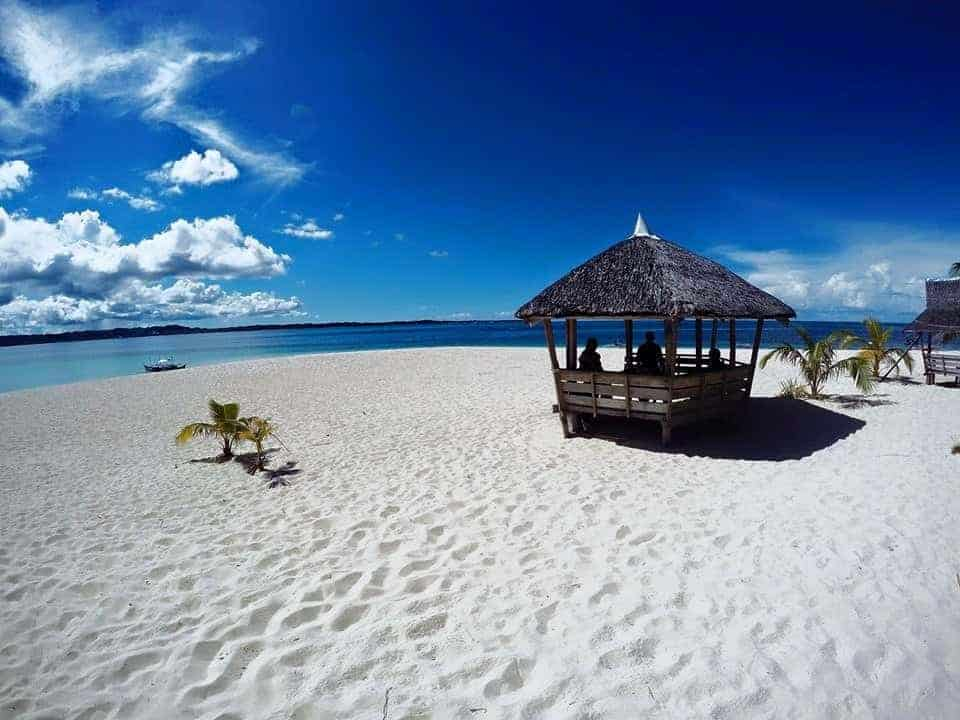 A wooden hut and white sand on the beach. Siargao Island, Philippines