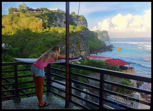 Girls looks out from her balcony at Uluwatu, Bali.