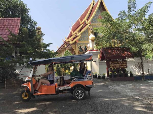 A Tuk Tuk and a Temple in Northern Thailand.