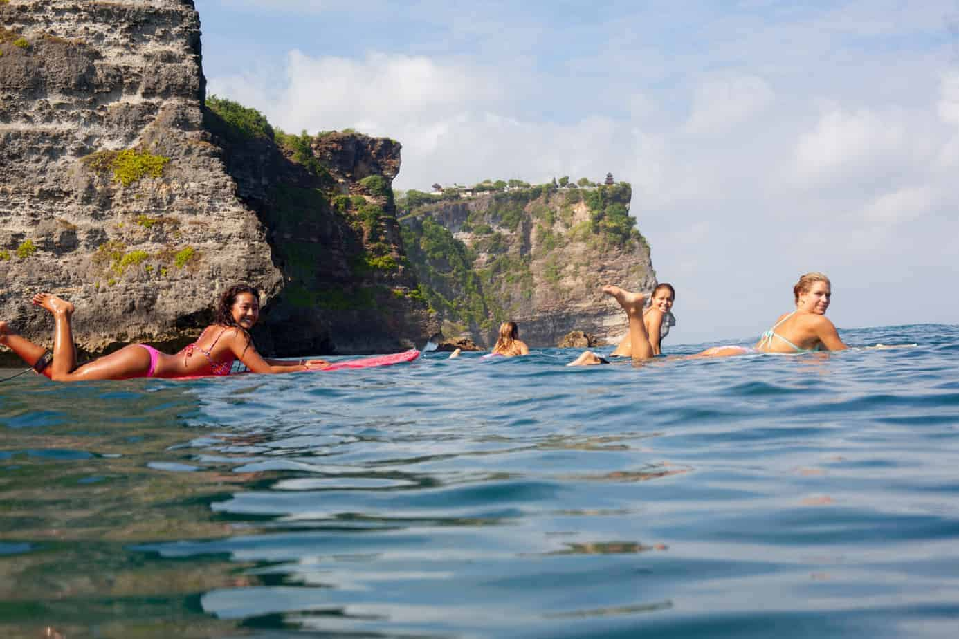 Girls surfing at Uluwatu, Bali, Indonesia