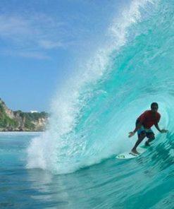 Surfing at Uluwatu, Bali.