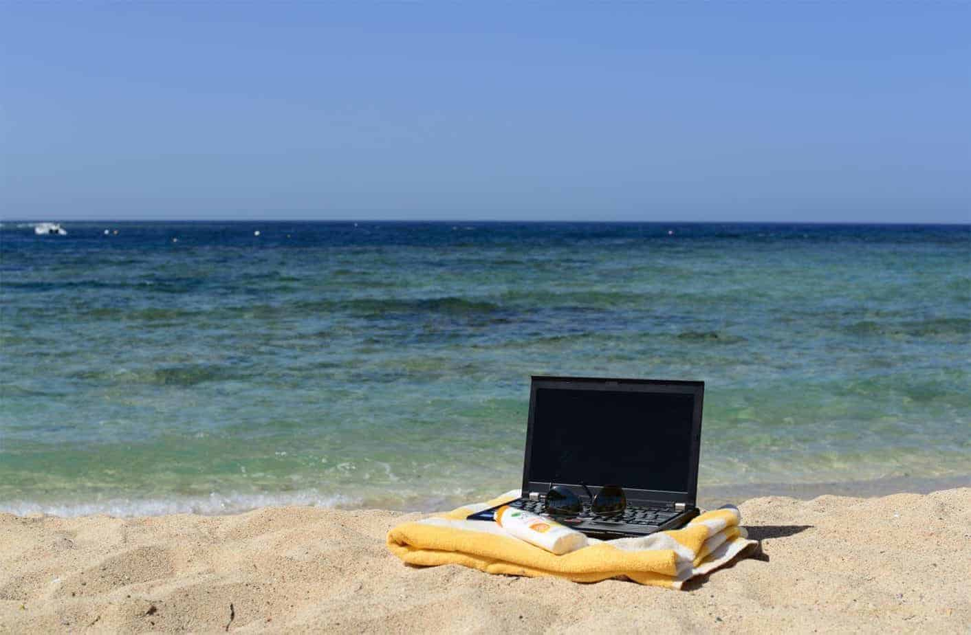 Laptop on a beach.