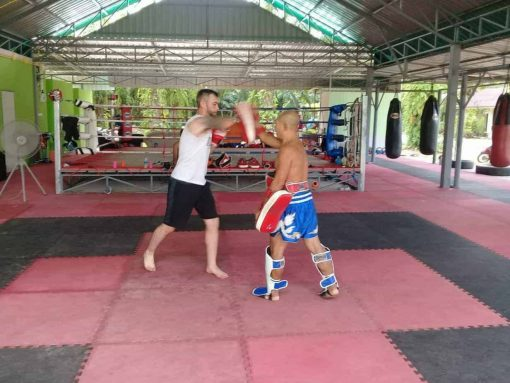 Honour Muay Thai, Krabi - Ajarn Lai and his student getting to grips with elbowing