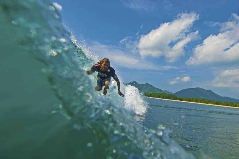 Surfing in Lhoknga Beach, Northern Sumatra.