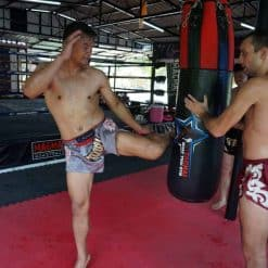 Fighting at Attachai Muay Thai Gym, Bangkok.