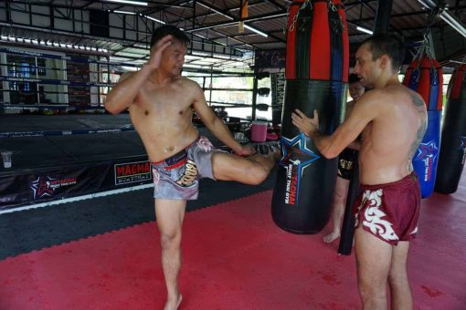 Fighting at Attachai Muay Thai Gym, Bangkok.