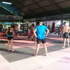Stretching before shadow work at Honour Muay Thai, Krabi