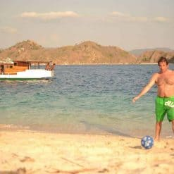 Playing football on the beach in Komodo
