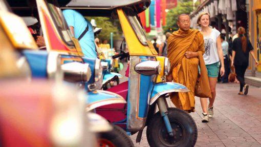 Tuk-tuks, a monk and a tourist in Bangkok