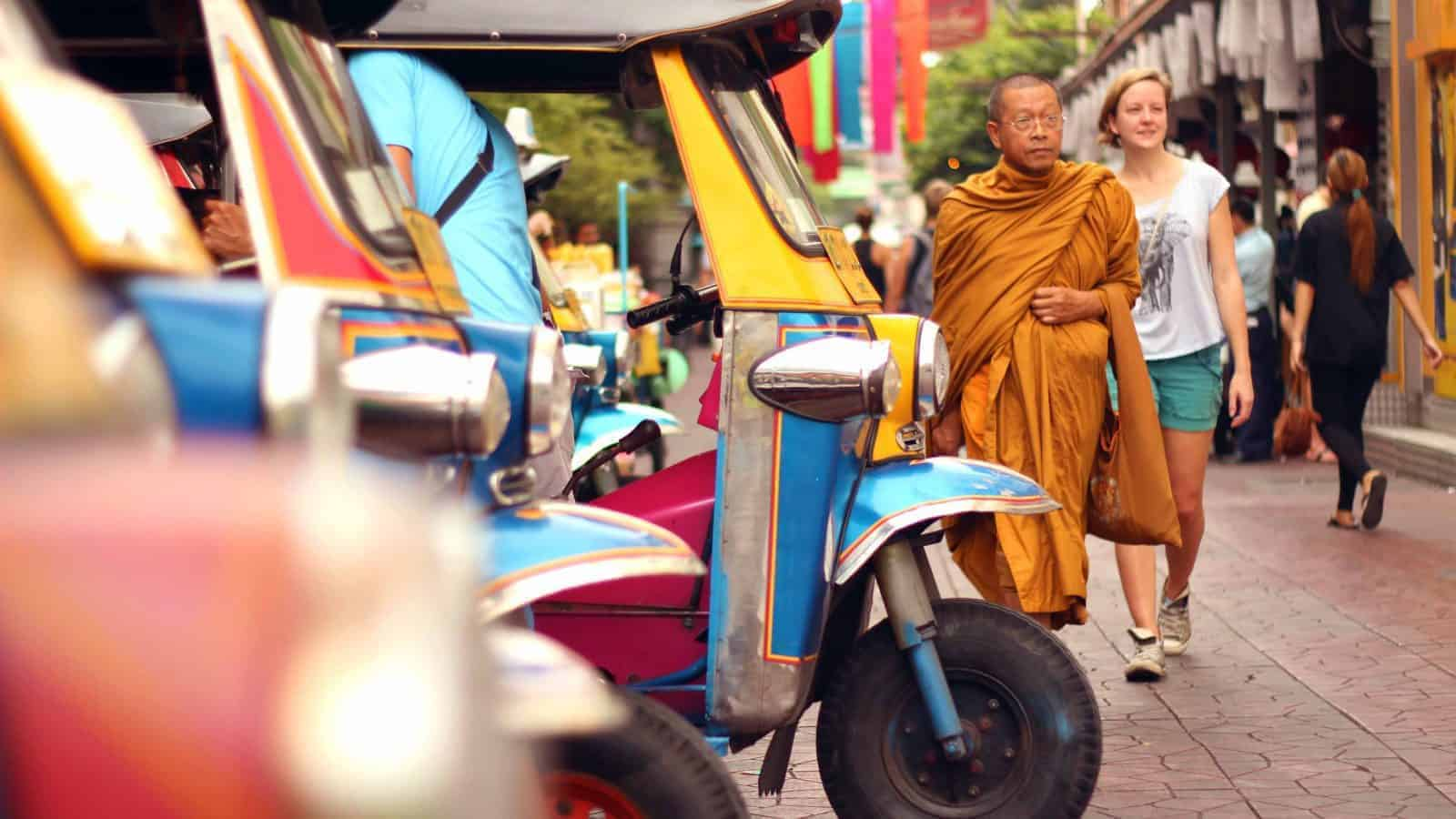 Tuk-tuks, a monk and a tourist in Bangkok