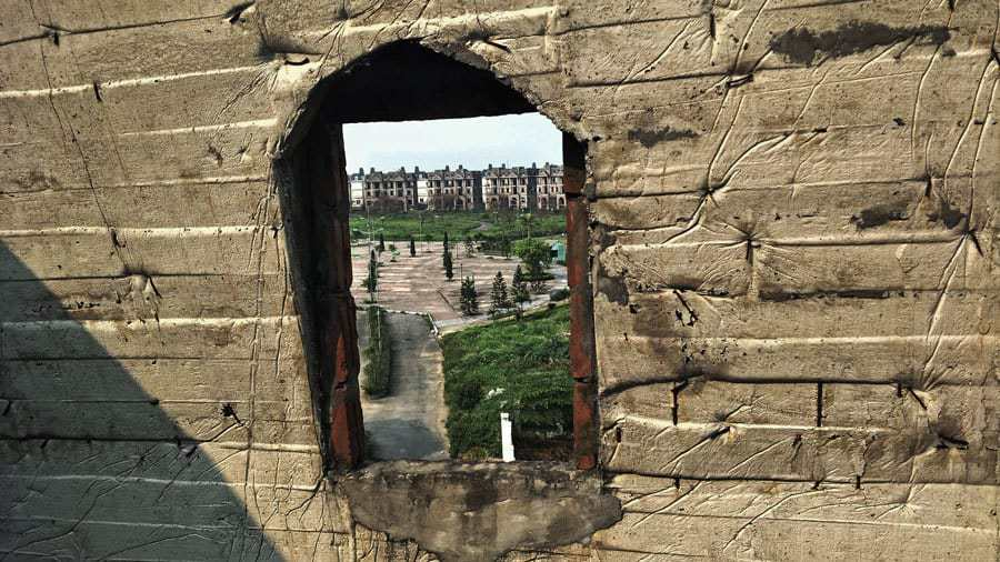 A view through a window in an abandoned building, Hanoi.