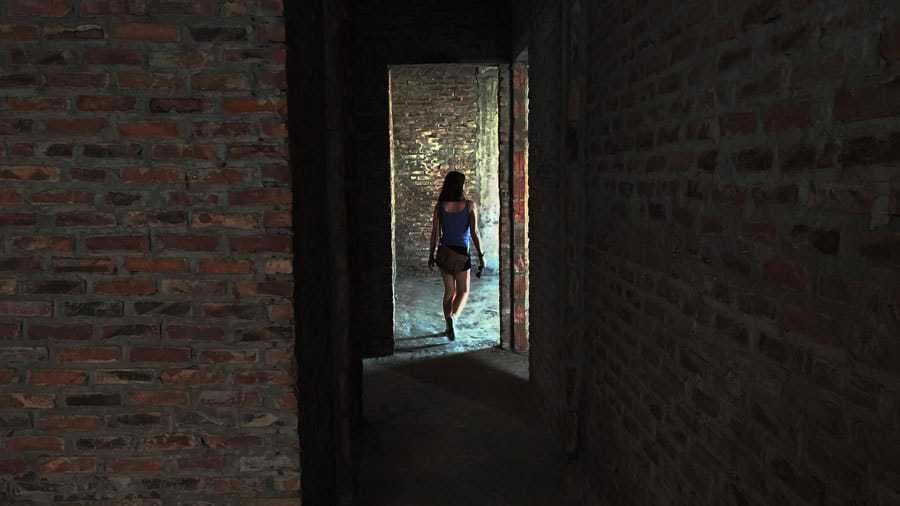 Nikki walks down a corridor of an abandoned building