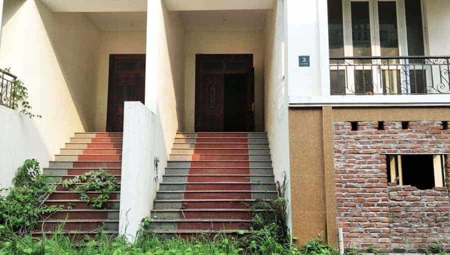 An open door to a partially built house.