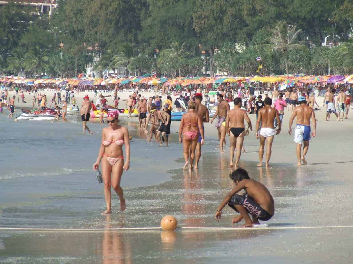 Tourists on Patong Beach, Phuket, Thailand.