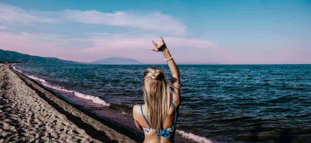 A girl on a beach in Asia.