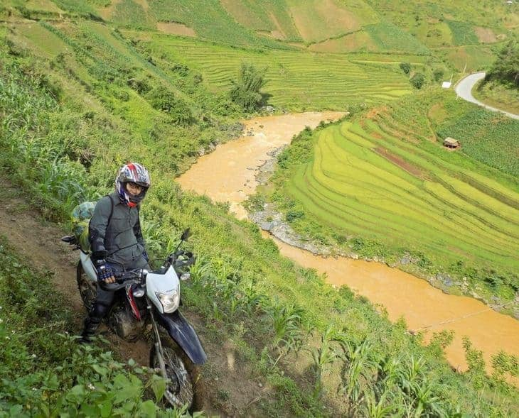 A Man On a Motorbike In The Rice Paddies of The Philippines