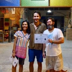 A student receives his Permaculture Design Certificate!