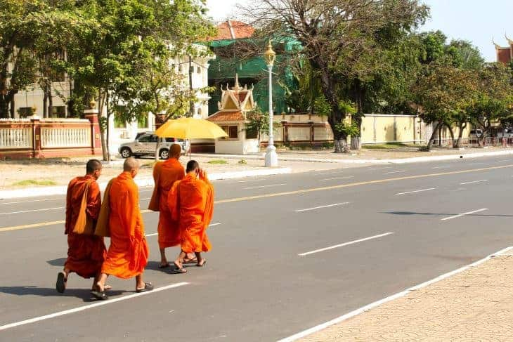 Monks crossing the road in Phnom Penh Cambodia