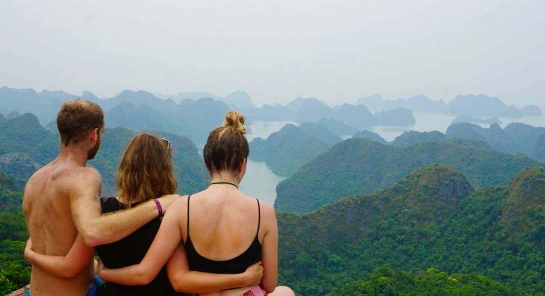 Three travellers look out over Halong Bay, Vietnam