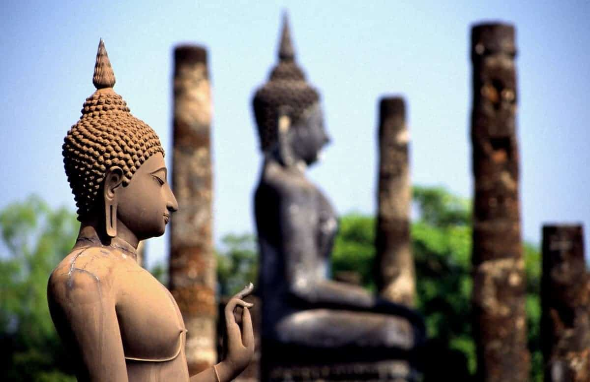 Buddha Statues Seen Side On At Sukhothai